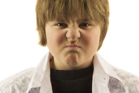 enraged: Young boy making silly face