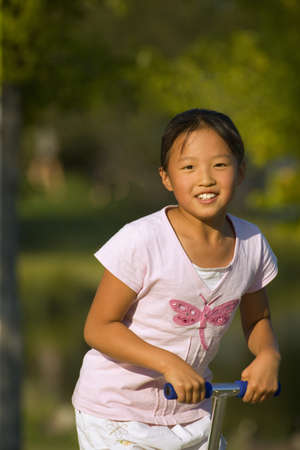 Front view of young girl on pogo stick   photo