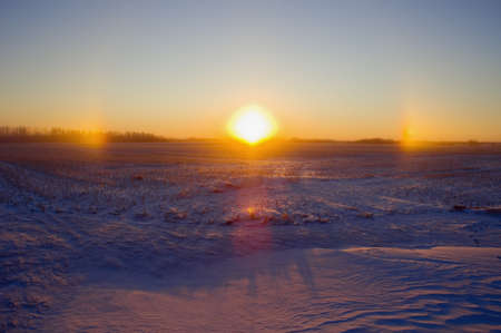 winter sunrise: Early morning with snow covered land