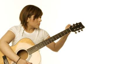 panoramics: Woman tuning a guitar Stock Photo
