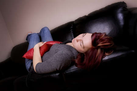 couch: Young woman sleeping on the couch