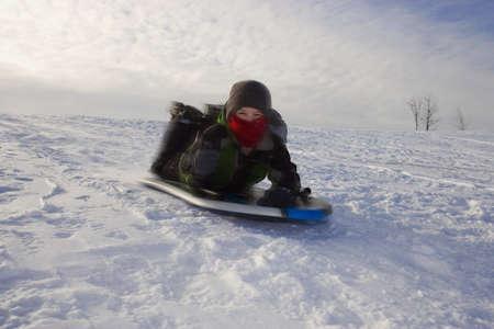 sledding: Boy tobogganing