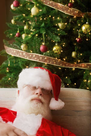 st nick: Santa Claus, asleep in front of Christmas tree