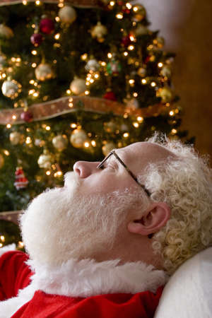seventy something: Santa Claus asleep by the Christmas tree