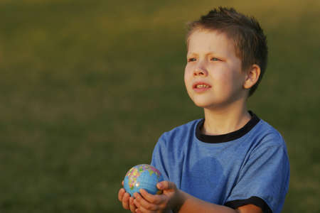 Boy holding a globe in his hands