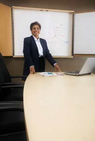 50 something fifty something: Businesswoman giving presentation