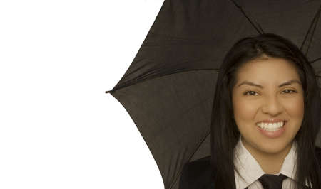 Woman smiling and holding umbrella Stock Photo - 7201027