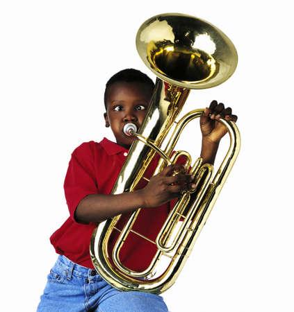 pre teen boys: Child playing baritone Stock Photo