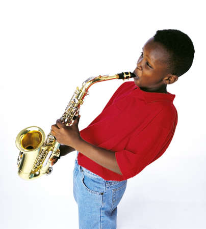 talented: Boy playing the saxophone Stock Photo