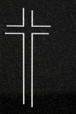 belief systems: Cross carved on granite