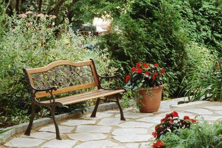 garden bench: Bench in a garden setting Stock Photo
