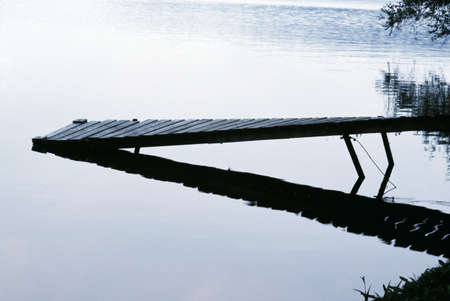 sloping: Pier sloping into the lake