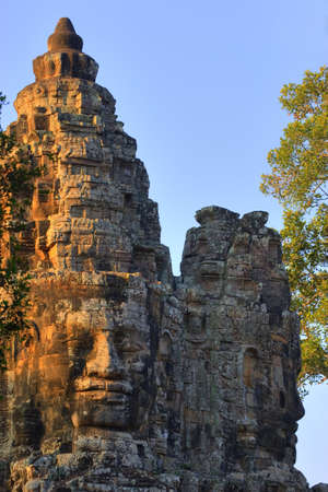 Stone heads on gate, Angkor Thom, Siem Reap, Cambodia Stock Photo - 7202652