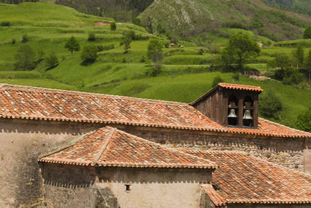 Pantiled roofs and church belfry in Carmona, Cantabria, Northern Spain Stock Photo - 7202635
