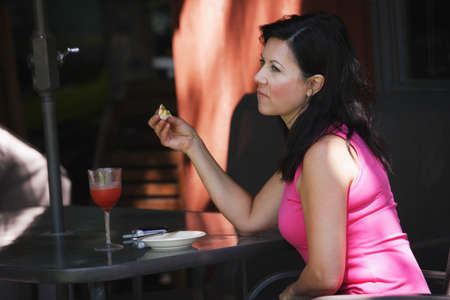 Woman eating alone photo