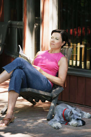 bookish: Woman relaxing with book on the deck