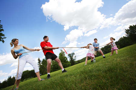 Tug of war between parents and kids Stock Photo - 7202565