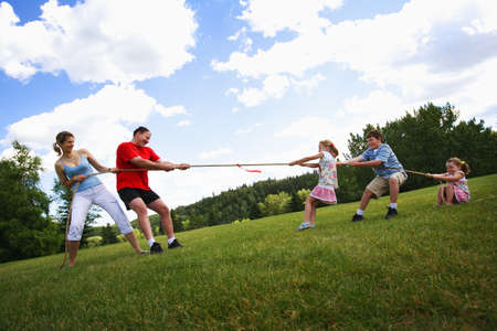 Tug of war between parents and kids photo