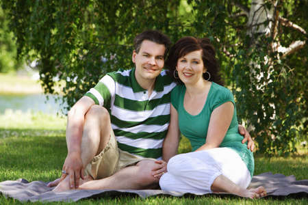 glubish: Portrait of a couple in the park Stock Photo