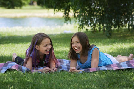 Two girls laughing together photo
