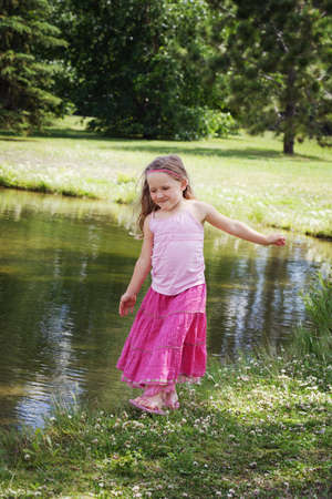 frolicking: Child by the water Stock Photo