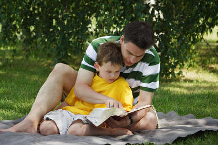 family units: Father reading to his son