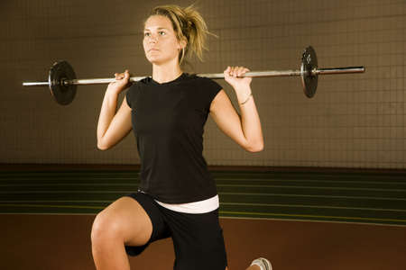 twentysomething: Woman lifting weights Stock Photo