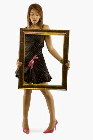 Woman holding picture frame Stock Photo - 7202694