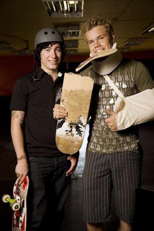 boarders: Two skateboarders together