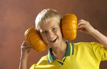 Boy playing with pumpkins Stock Photo - 7202610