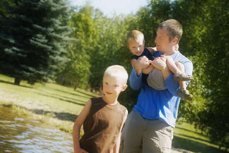 30 34 years: Front view of father playing with children Stock Photo