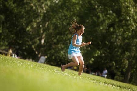 Girl running in the park Stock Photo - 7202703