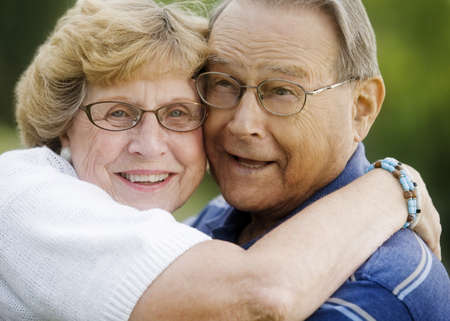 seventy something: Portrait of senior couple hugging