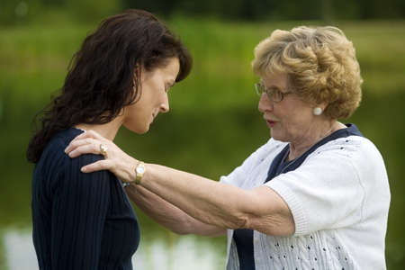 seventy something: Senior woman consoling her daughter Stock Photo
