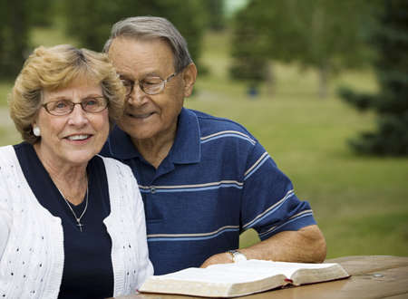 christian faith: Senior couple with their Bible