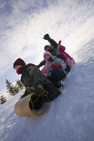 Children Tobogganing   Stock Photo