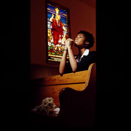 Boy praying in church photo