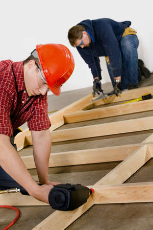 30 something: Carpenters building a frame
