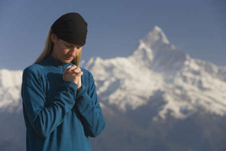 bowing head: A woman in prayer Stock Photo