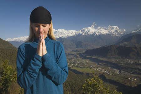 intercessors: A woman in prayer Stock Photo