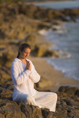 Woman praying photo