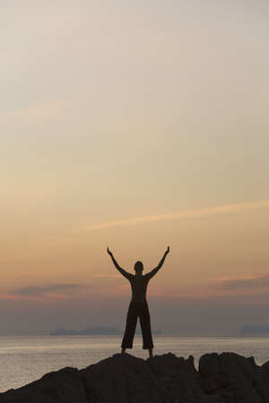 victorious: Person with arms raised