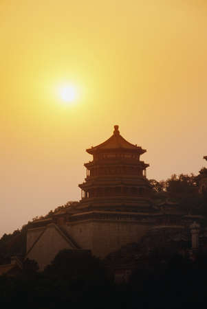 belief system: Pagoda in Summer Palace at sunset in Beijing, China    Stock Photo