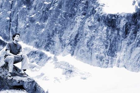 A man sitting on rock Stock Photo - 7208561