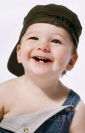 Head and shoulders portrait of a boy laughing Stock Photo - 7205781