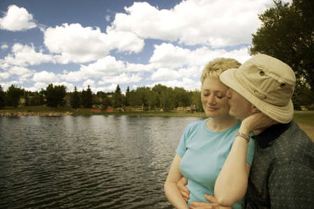 60 years old: A couple by a lake