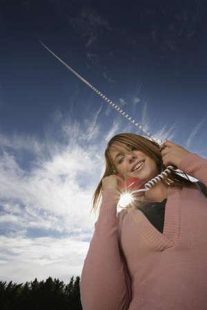 Woman talking on phone Stock Photo