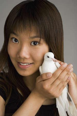 A woman holding a dove photo