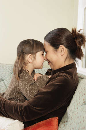 rubbing noses: Mother and daughter