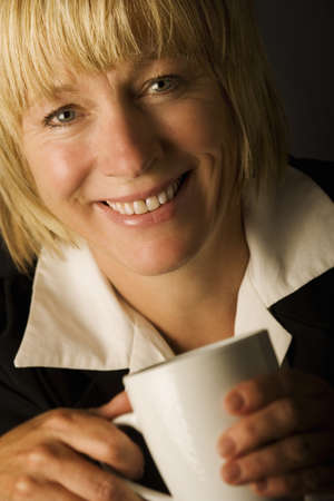A woman holding a mug photo